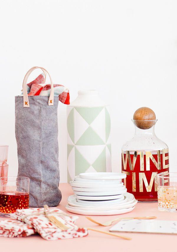 """<p>What Dad doesn't love wine? With this fun DIY, you'll be able to spruce up the classic gift with a little homemade love.</p><p><strong>Get the tutorial at <a href=""""https://www.papernstitchblog.com/canvas-wine-bag-diy/"""" rel=""""nofollow noopener"""" target=""""_blank"""" data-ylk=""""slk:Paper and Stitch"""" class=""""link rapid-noclick-resp"""">Paper and Stitch</a>.</strong></p><p><a class=""""link rapid-noclick-resp"""" href=""""https://www.amazon.com/Mybecca-Unprimed-Cotton-Canvas-Natural/dp/B01ATX24NI/ref=sr_1_6?tag=syn-yahoo-20&ascsubtag=%5Bartid%7C10050.g.1171%5Bsrc%7Cyahoo-us"""" rel=""""nofollow noopener"""" target=""""_blank"""" data-ylk=""""slk:SHOP CANVAS FABRIC"""">SHOP CANVAS FABRIC</a> <br></p>"""