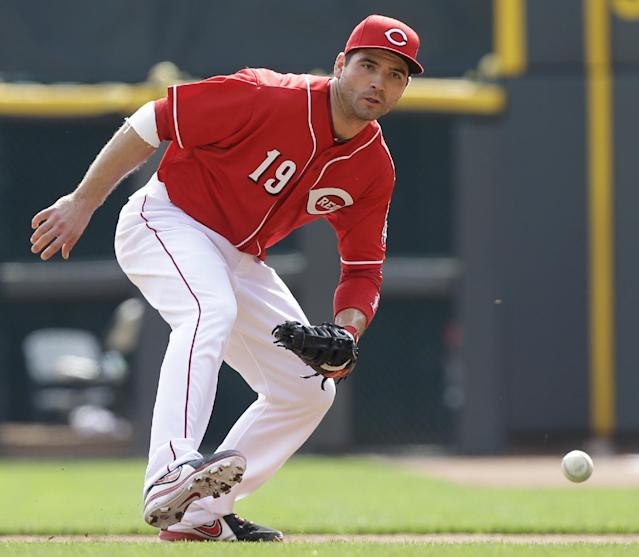 Cincinnati Reds first baseman Joey Votto (19) fields a ground ball hit by New York Mets' Juan Centeno in the fourth inning of a baseball game, Wednesday, Sept. 25, 2013, in Cincinnati. Votto threw Centeno out. (AP Photo/Al Behrman)