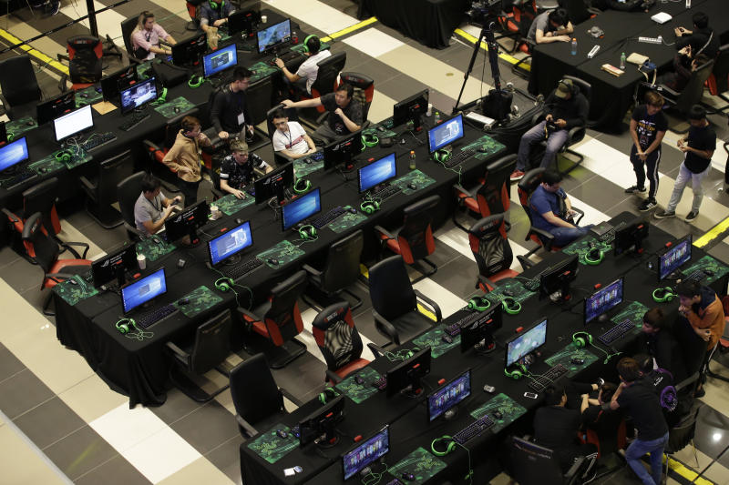 In this Thursday, Aug. 29, 2019 photo, esport (electronic sport) players participate during the qualifying rounds for the first Philippine esport team in metropolitan Manila, Philippines. Esports, a form of competition using video games, will be making its debut as a medal sport at the 30th South East Asian Games in the country which starts November this year. (AP Photo/Aaron Favila)