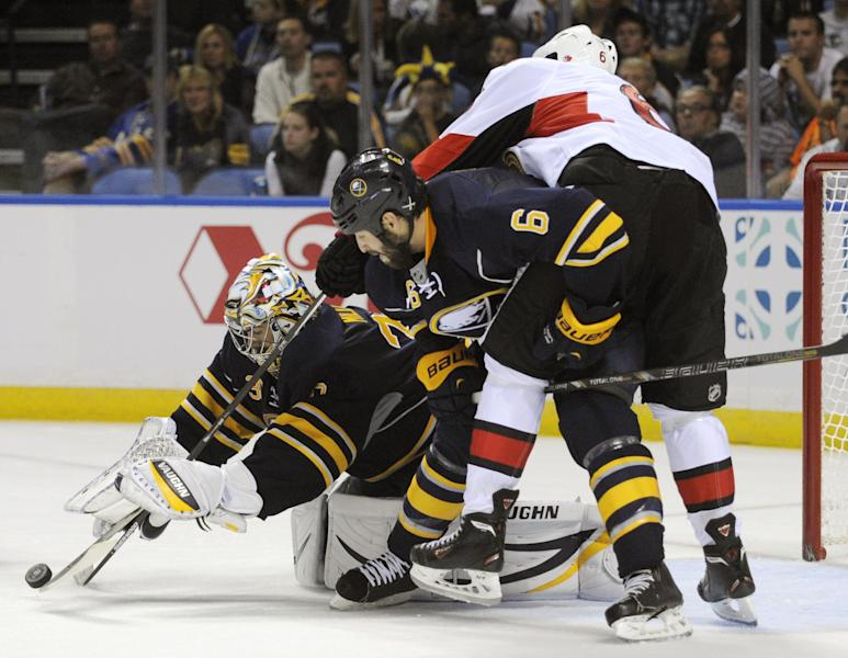 Buffalo Sabres goalie Ryan Miller (30) reaches for the puck as Sabres' Mike Weber (6) checks Ottawa Senators' Bobby Ryan (6) during the second period of an NHL hockey game in Buffalo, N.Y., Friday, Oct. 4, 2013. (AP Photo/Gary Wiepert)