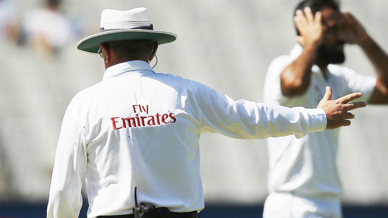 An umpire signals for a no-ball.