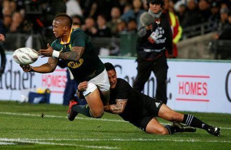 South Africa's Elton Jantjies passes the ball. REUTERS/Nigel Marple