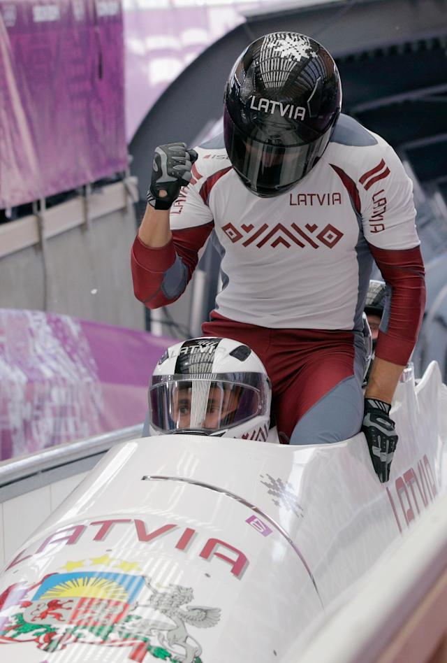 SOCHI, RUSSIA - FEBRUARY 23: Pilot Oskars Melbardis, Daumants Dreiskens, Arvis Vilkaste and Janis Strenga of Latvia team 1 react after the final run during the Men's Four-Man Bobsleigh on Day 16 of the Sochi 2014 Winter Olympics at Sliding Center Sanki on February 23, 2014 in Sochi, Russia. (Photo by Adam Pretty/Getty Images)