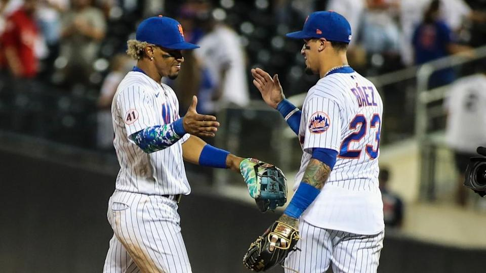 Sep 12, 2021; New York City, New York, USA; New York Mets shortstop Francisco Lindor(12) and second baseman Javier Baez (23) celebrate after defeating the New York Yankees 7-6 at Citi Field.