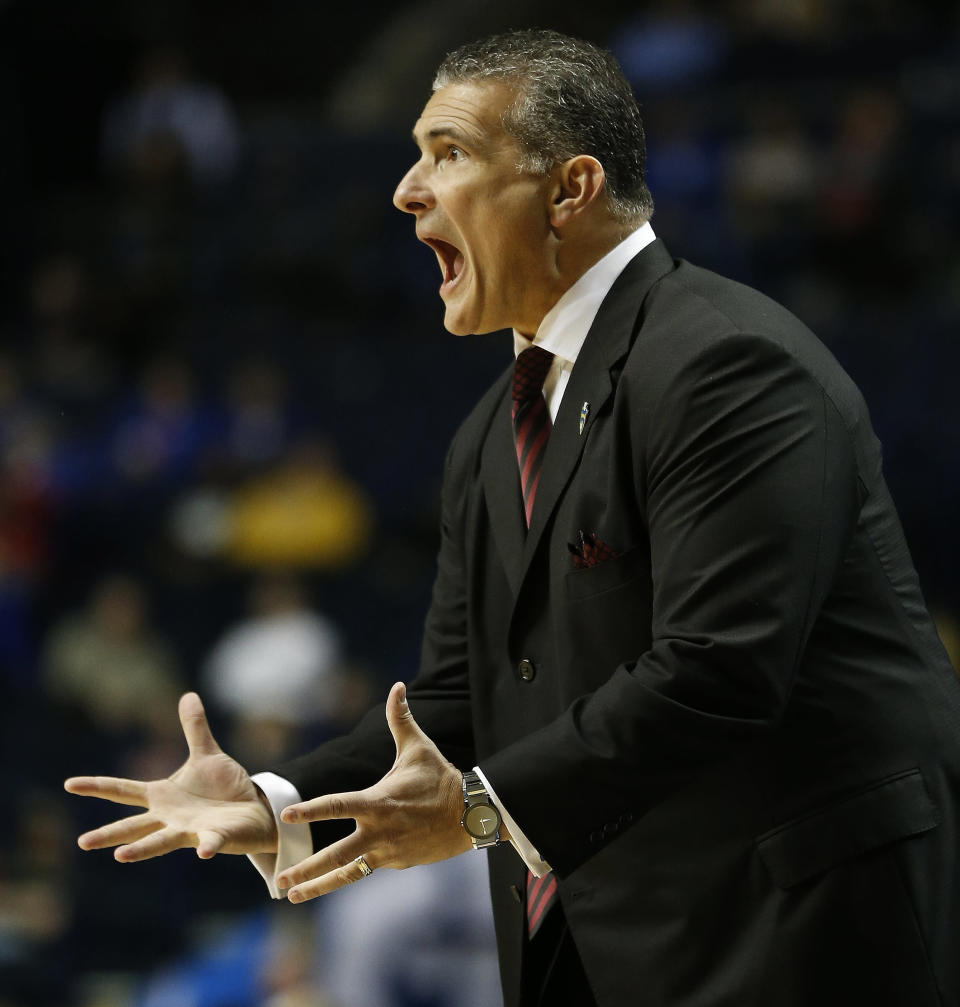South Carolina head coach Frank Martin shouts during the first half of an NCAA college basketball game in the first round of the Southeastern Conference tournament against Missouri, Wednesday, March 11, 2015, in Nashville, Tenn. (AP Photo/Steve Helber)