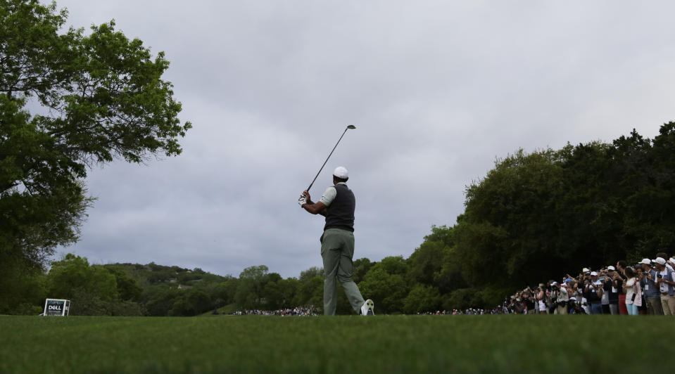 Tiger Woods hits his drive on the third hole during fourth round play at the Dell Technologies Match Play Championship golf tournament, Saturday, March 30, 2019, in Austin, Texas.
