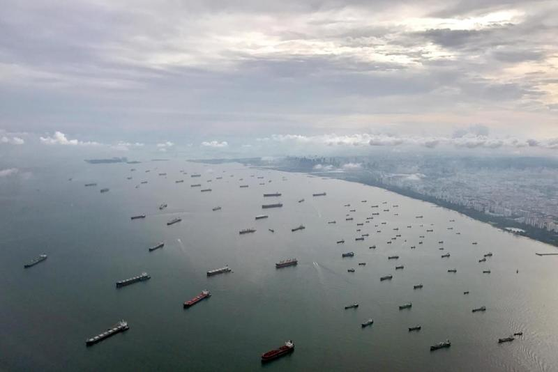 Vessels anchored along the Singapore Strait. Singaporean ministers have made fiery claims that Malaysia 'encroached' on their country's territorial waters by extending the Johor Baru port limits. — Reuters pic