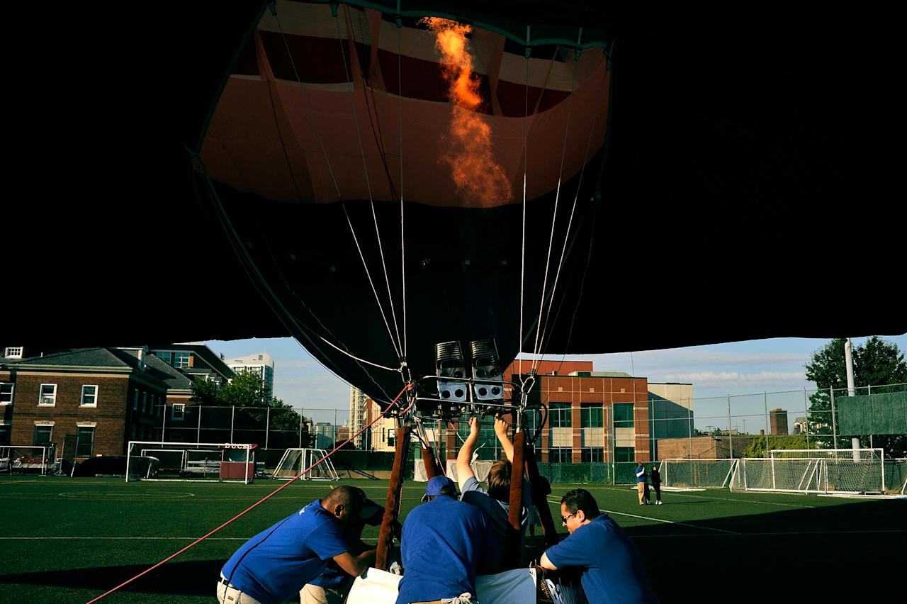 Crews work to inflate the PNC American Flag balloon in honor of America for Independence Day on the De Baun Athletic Complex at Stevens Institute of Technology on July 3, 2012 in Hoboken, New Jersey. The 53 by 78 foot balloon is the world's largest free-flying American flag, weighs 530 pounds and is being flown in the upcoming 30th annual NJ Festival of Ballooning. (Photo by Michael Bocchieri/Getty Images)