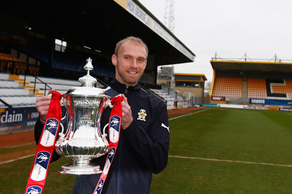 CAMBRIDGE, ENGLAND - JANUARY 19:  Luke Chadwick of Cambridge United holds the FA Cup trophy at the Abbey Stadium on January 19, 2015 in Cambridge, Cambridgeshire.  (Photo by Julian Finney/Getty Images)