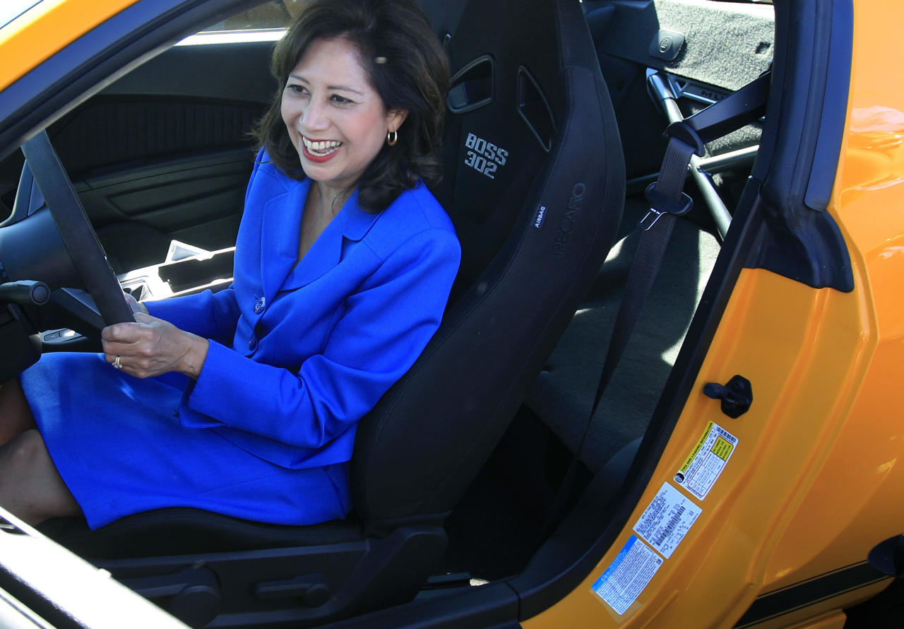 U.S. Secretary of Labor Hilda Solis smiles as she hears the engine of a 2013 Boss 302 Mustang at the Flat Rock Assembly in Flat Rock, Mich., Monday, Sept. 10, 2012. The plant, formerly known as AutoAlliance International will continue to produce the Mustang and add the Fusion next year. Flat Rock Assembly will be the U.S. producer of the Fusion, employing 2,900 workers on both vehicle lines. (AP Photo/Carlos Osorio)