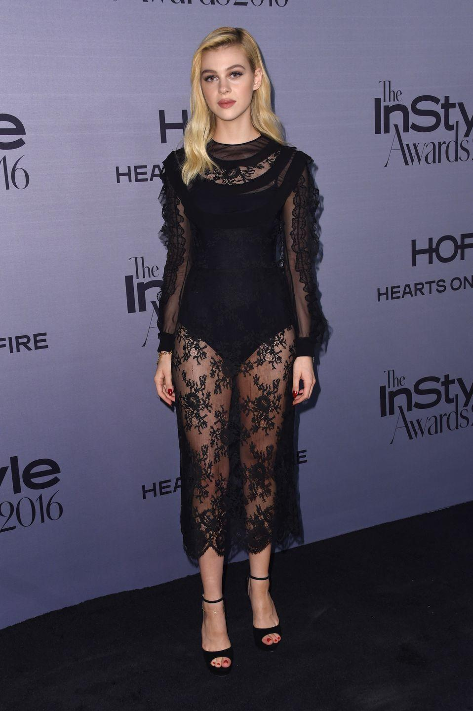 <p><span>The star attended the </span>InStyle<span> Awards in a sheer black midi dress with black heels. </span><br></p>