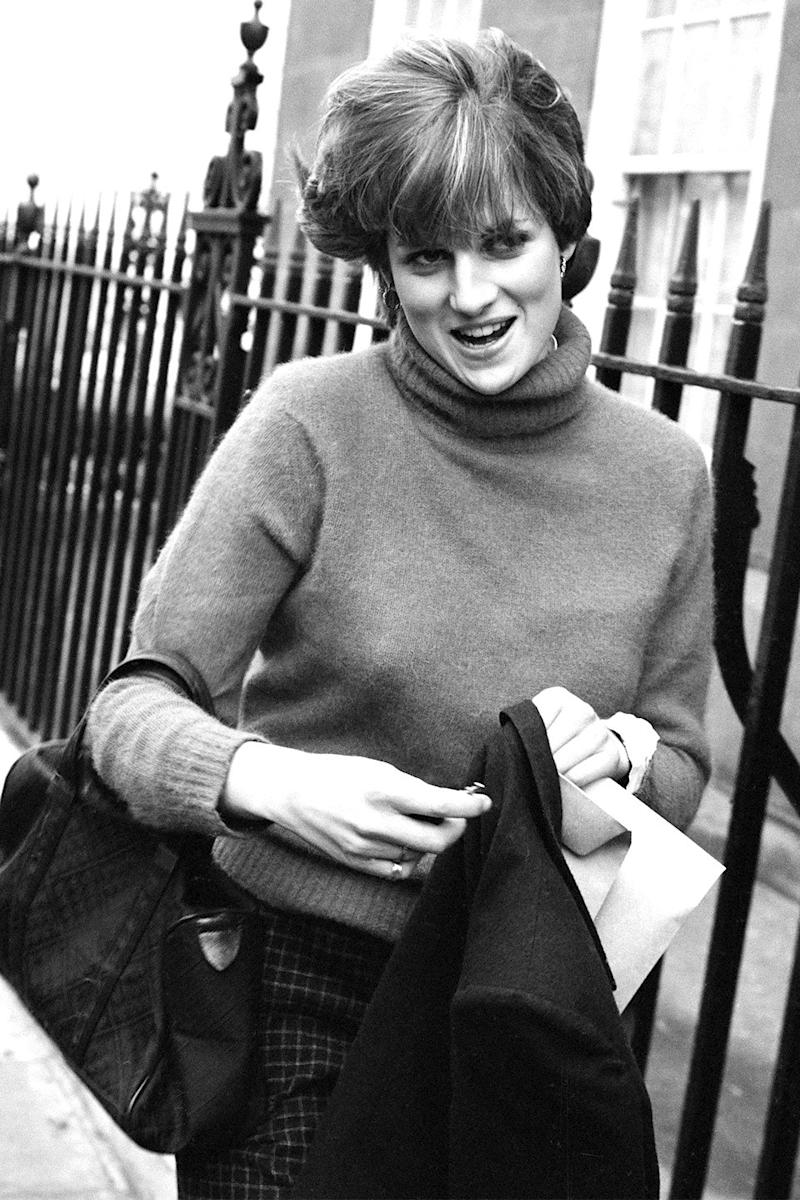 Diana walking in Chelsea a year before she was to marry Prince Charles, whom she'd met three years prior when he attended a country weekend at the Spencer ancestral home, Althorp.