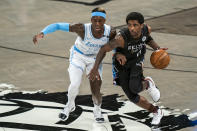 Los Angeles Lakers guard Dennis Schroeder (17) defends against Brooklyn Nets guard Kyrie Irving (11) during the first half of an NBA basketball game Saturday, April 10, 2021, in New York (AP Photo/Corey Sipkin)