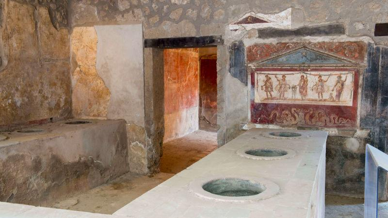 Remains of an ancient home with snack bar in Pompeii