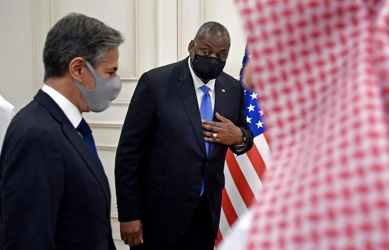US Secretary of State Antony Blinken, left, and Secretary of Defense Lloyd Austin arrive for a joint press conference in Doha (AFP/Olivier DOULIERY)