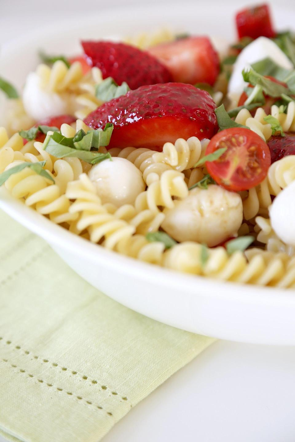 """<p>Traditional caprese calls for tomatoes, but switch things up with juicy strawberries if you're feeling adventurous. Topped off with bits of basil, every bite of this is a treat.</p> <p><strong>Get the recipe:</strong> <a href=""""http://www.popsugar.com/food/Strawberry-Caprese-Pasta-Salad-40921523/"""" class=""""link rapid-noclick-resp"""" rel=""""nofollow noopener"""" target=""""_blank"""" data-ylk=""""slk:strawberry caprese pasta salad"""">strawberry caprese pasta salad</a></p>"""