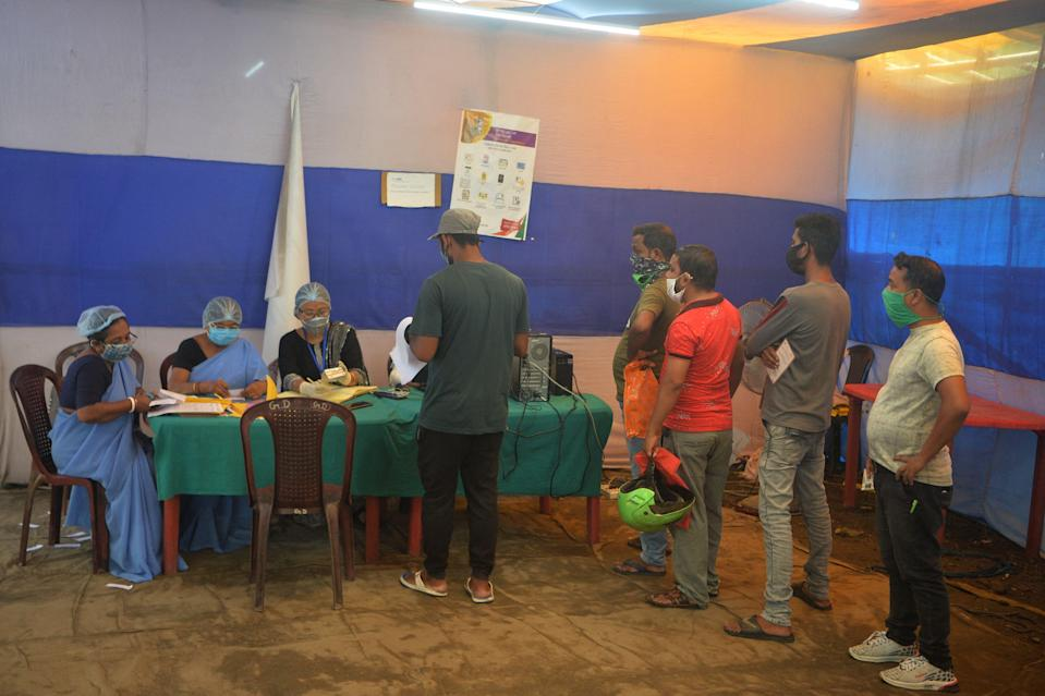 <p>People over 18 years-old register to receive a dose of vaccine at a health centre in Siliguri on 2 June, 2021.</p> (AFP via Getty Images)