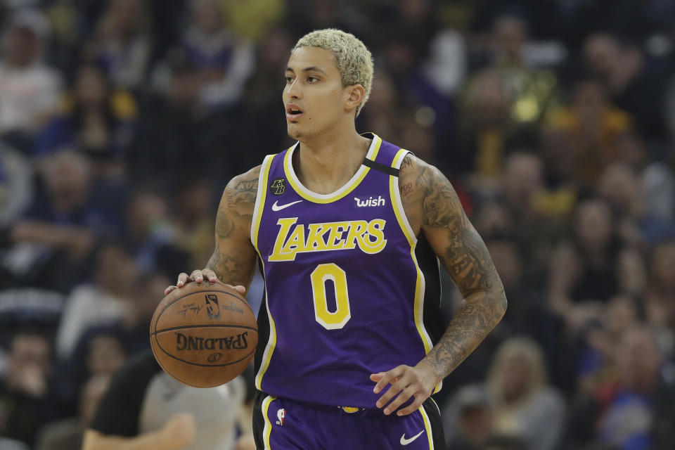Los Angeles Lakers forward Kyle Kuzma (0) dribbles the ball up the court against the Golden State Warriors during the first half of an NBA basketball game in San Francisco, Thursday, Feb. 27, 2020. (AP Photo/Jeff Chiu)