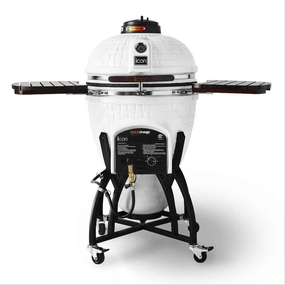 This photo provided by Williams Sonoma shows the Icon Hybrid Kamado Grill. Many serious grill enthusiasts opt for the kamado style grill – the word means 'stove' in Japanese – that has a distinctive oval shape. With top and bottom vents, these grills have thick ceramic heat-trapping walls that make them heat up quickly, and work much like convection ovens. This hybrid kamado grill, available only at Williams Sonoma, takes either charcoal or gas. Its white exterior makes it look a little like R2D2. (Williams Sonoma via AP)