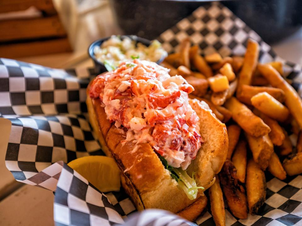 Lobster roll with fries.
