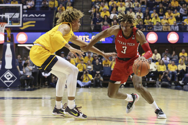 Texas Tech guard Jahmi'us Ramsey (3) drives the ball upcourt as he is defended by West Virginia forward Emmitt Matthews Jr. (11) during the first half of an NCAA college basketball game Saturday, Jan. 11, 2020, in Morgantown, W.Va. (AP Photo/Kathleen Batten)