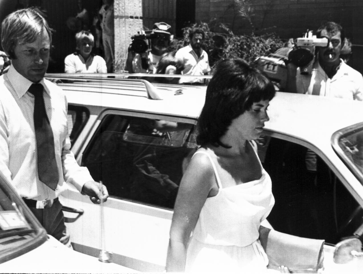 "FILE - In this Feb. 2, 1982, file photo, Michael and Lindy Chamberlain leave a courthouse in Alice Springs, Australia. ""The dingo's got my baby!"" With those panicked words, the mystery of Azaria Chamberlain's disappearance in the Australian Outback in 1980 became the most notorious, divisive and baffling legal drama in the country's history. Had a wild dog really taken the baby? Or had Azaria's mother, Lindy, slit her daughter's throat and buried her in the desert? Thirty-two years later, Australian officials hope to finally, definitively, determine how Azaria died when the Northern Territory coroner opens a fourth inquest on Friday, Feb. 24, 2012. (AP Photo)"