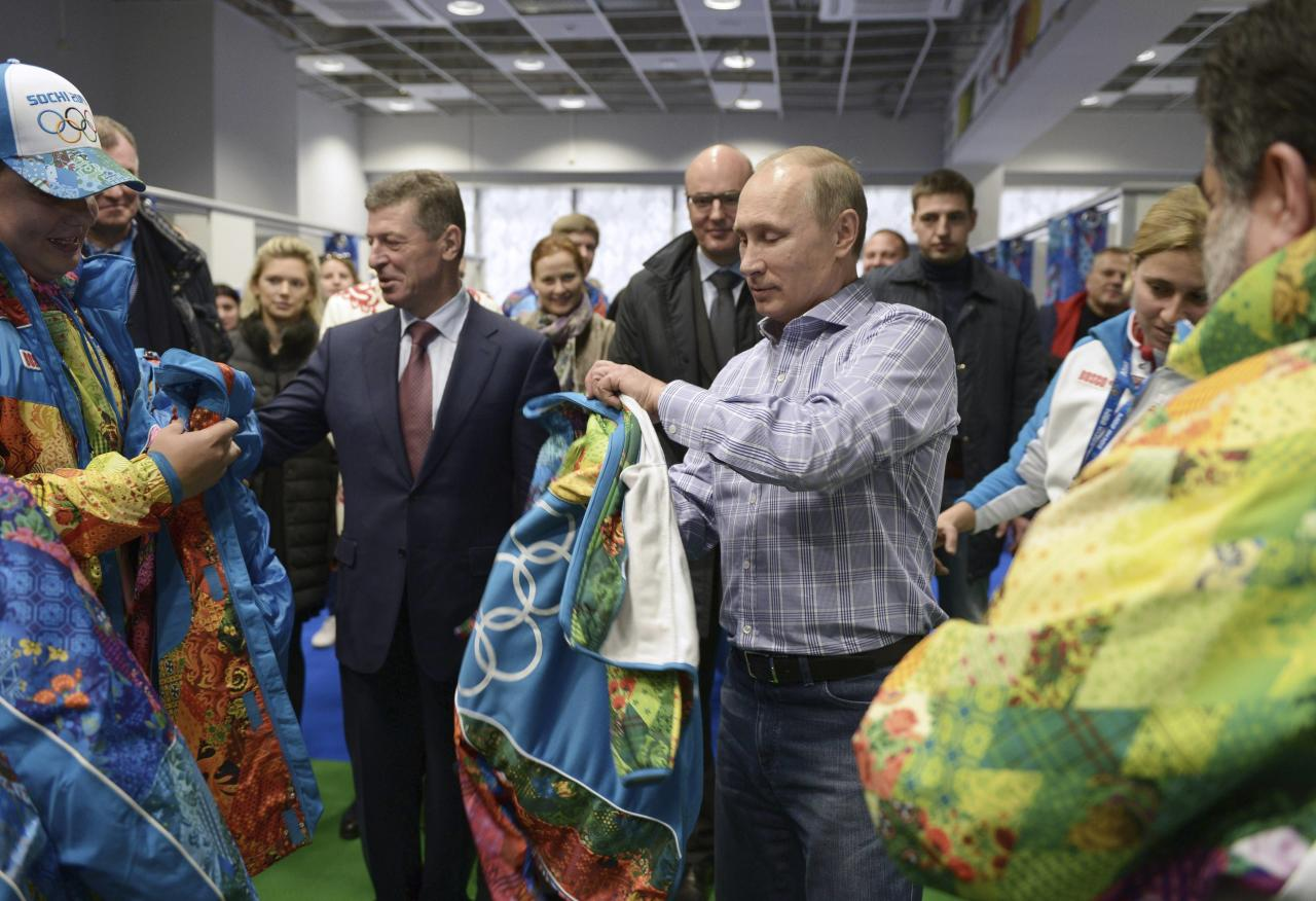 Russia's President Vladimir Putin (R), Organising Committee Head Dmitry Chernyshenko (C) and Deputy Prime Minister Dmitry Kozak (L) visit an Olympic volunteer's centre in Sochi January 4, 2014. REUTERS/Alexei Nikolskiy/RIA Novosti/Kremlin (RUSSIA - Tags: POLITICS SPORT OLYMPICS) ATTENTION EDITORS - THIS IMAGE HAS BEEN SUPPLIED BY A THIRD PARTY. IT IS DISTRIBUTED, EXACTLY AS RECEIVED BY REUTERS, AS A SERVICE TO CLIENTS