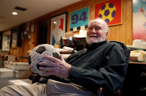 Dick Cecil, vice president and chief architect of the Atlanta Chiefs soccer club, holds a ball signed by the 1968 championship team at his home in Atlanta, Wednesday, Dec. 5, 2018. Cecil still has the championship trophy, tucked away somewhere in his home, a cherished prize that has been reduced to bits and pieces by the ravages of time. (AP Photo/John Bazemore)