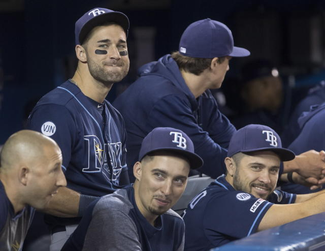 Tampa Bay Rays Kevin Kiermaier, top left, relaxes in the dugout with teammates in the fourth inning of a baseball game against the Toronto Blue Jays in Toronto Saturday Sept. 28, 2019. (Fred Thornhill/The Canadian Press via AP)