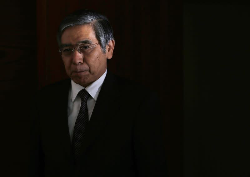 Bank of Japan Governor Kuroda walks into a news conference at the BOJ headquarters in Tokyo