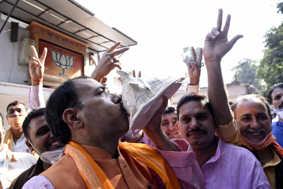 India's ruling Bharatiya Janata Party (BJP) supporters celebrate the lead of their party alliance in initial results for the Bihar state assembly polls, in Patna, India, Tuesday, Nov. 10, 2020. (AP Photo/Aftab Alam Siddiqui)