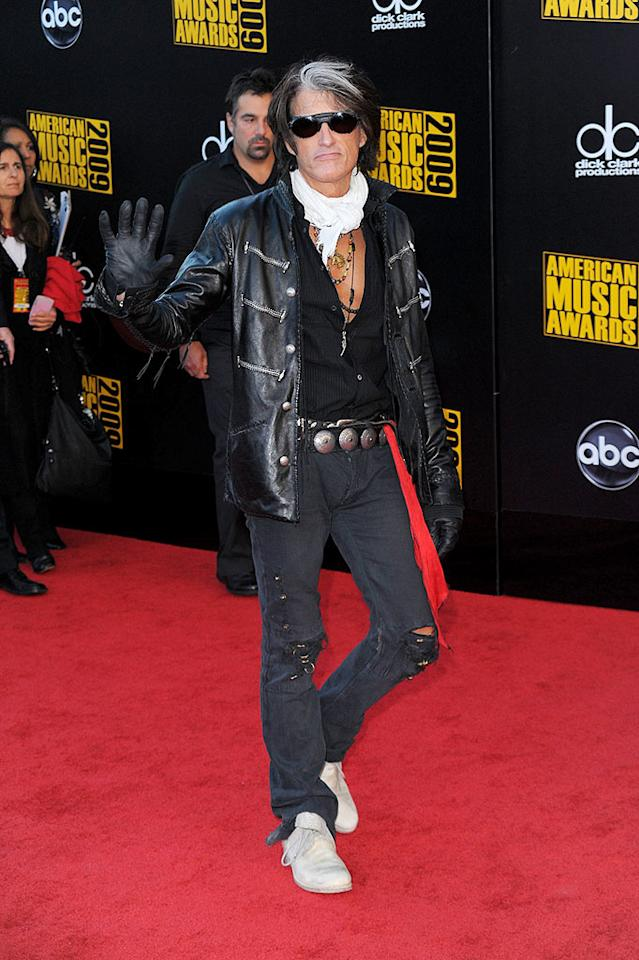 "Joe Perry  Grade: C-  We love us some Joe Perry, but Aerosmith's 59-year-old lead guitarist was trying a tad too hard to fit in with all the youngsters on the red carpet. Jason Merritt/<a href=""http://www.gettyimages.com/"" target=""new"">GettyImages.com</a> - November 22, 2009"