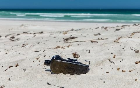 <span>The bottle was found on a remote beach 100 miles north of Perth</span> <span>Credit: KymIllman.com </span>