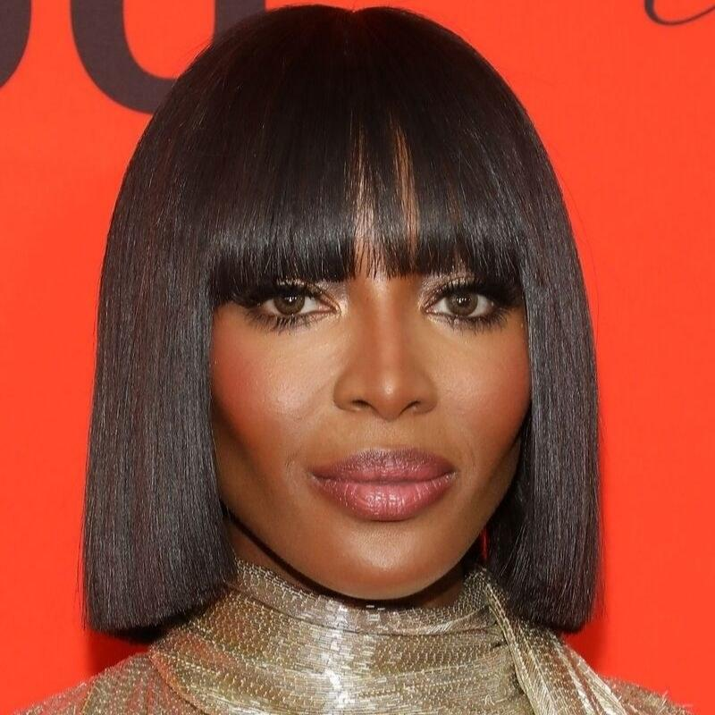"""If you're going to try a '90s trend, it's best to go to a '90s supermodel for inspiration. <a href=""""https://www.allure.com/topic/naomi-campbell?mbid=synd_yahoo_rss"""">Naomi Campbell</a>'s bob is made even sleeker with bold bangs — another 2019 fall haircut trend. """"What I love is that it's a cut that can be well suited with a fringe, which adds strength to a [one's] personality,"""" says Stone."""
