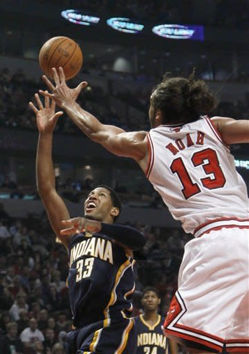Indiana Pacers small forward Danny Granger (33) shoots over Chicago Bulls center Joakim Noah, during the first half of an NBA preseason basketball game Tuesday, Dec. 20, 2011 in Chicago. (AP Photo/Charles Rex Arbogast)