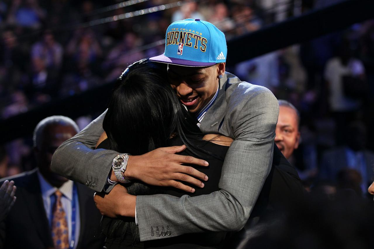 NEWARK, NJ - JUNE 28:  Anthony Davis (R) of the Kentucky Wildcats hugs his mother Eranier after he was selected number one overall by the New Orleans Hornets during the first round of the 2012 NBA Draft at Prudential Center on June 28, 2012 in Newark, New Jersey. NOTE TO USER: User expressly acknowledges and agrees that, by downloading and/or using this Photograph, user is consenting to the terms and conditions of the Getty Images License Agreement.  (Photo by Elsa/Getty Images)