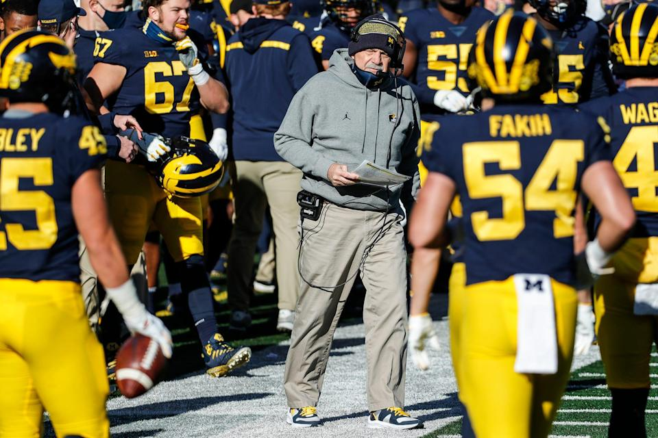 Michigan defensive coordinator Don Brown talks to players during a timeout during the first half against Penn State at Michigan Stadium in Ann Arbor, Saturday, Nov. 28, 2020.