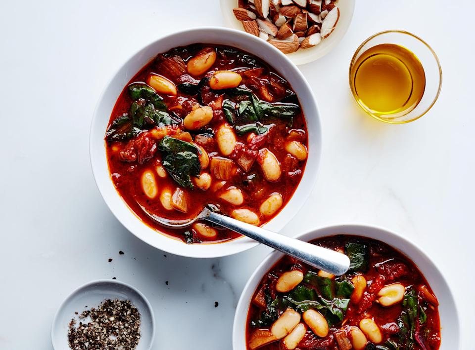 "You can swap other greens, like spinach, for the chard in this bean soup recipe. It tastes even better after being chilled for a day or two. <a href=""https://www.bonappetit.com/recipe/tomato-and-cannellini-bean-soup?mbid=synd_yahoo_rss"" rel=""nofollow noopener"" target=""_blank"" data-ylk=""slk:See recipe."" class=""link rapid-noclick-resp"">See recipe.</a>"
