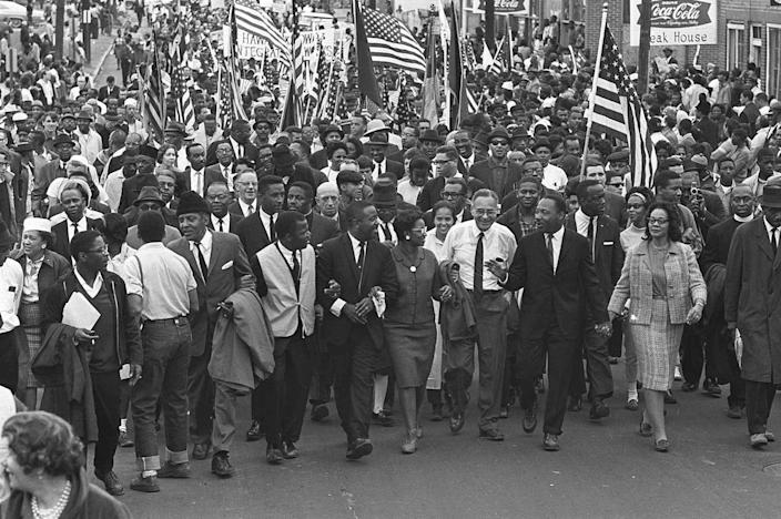 <p>Dr. Martin Luther King, third from right, marchers across the Alabama River on the first of a five day, 50 mile march to the state capitol at Montgomery, Ala., on March 21, 1965. (AP Photo) </p>