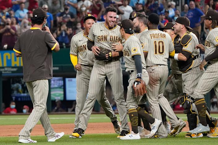 Padres starting pitcher Joe Musgrove (middle) celebrates his no-hitter with his teammates.