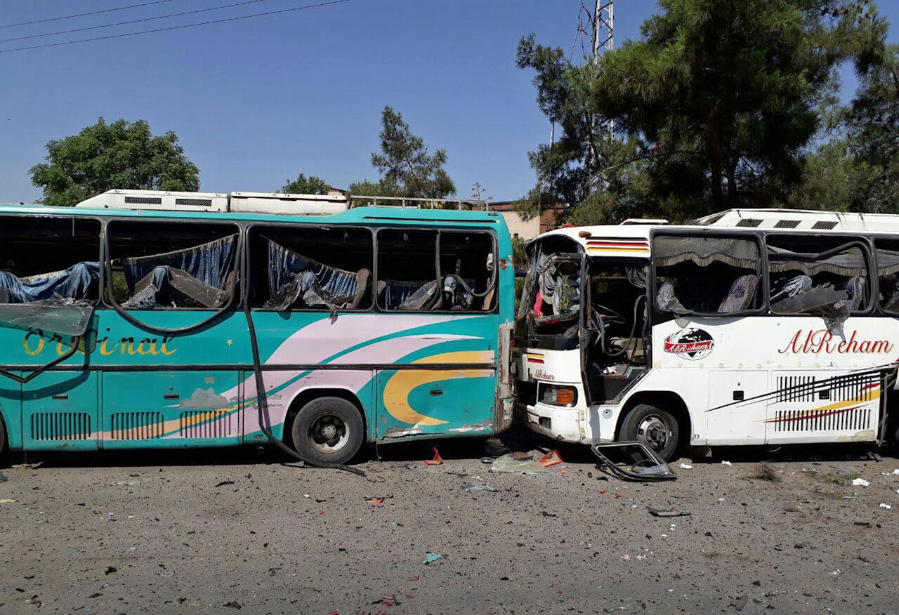 <p>This photo released by the Syrian official news agency SANA, shows several damaged buses along the road to the airport in southeast Damascus, Syria, Sunday, July 2, 2017. Syrian state TV said Sunday that a series of car bomb explosions have rocked the capital, resulting in multiple casualties. (SANA via AP) </p>