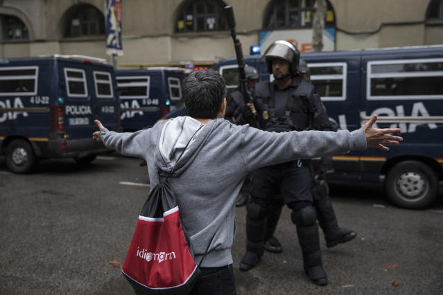 <p>Pro-Referendum supporters clash with members of the Spanish National Police, after police tried to enter a polling station to retreive ballot boxes during today's referendum vote on Oct. 1, 2017 in Barcelona, Spain. (Photo: Dan Kitwood/Getty Images) </p>