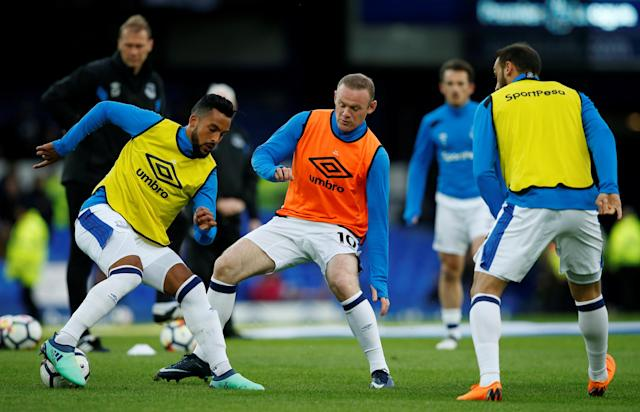 "Soccer Football - Premier League - Everton v Newcastle United - Goodison Park, Liverpool, Britain - April 23, 2018 Everton's Theo Walcott and Wayne Rooney during the warm up before the match REUTERS/Andrew Yates EDITORIAL USE ONLY. No use with unauthorized audio, video, data, fixture lists, club/league logos or ""live"" services. Online in-match use limited to 75 images, no video emulation. No use in betting, games or single club/league/player publications. Please contact your account representative for further details."