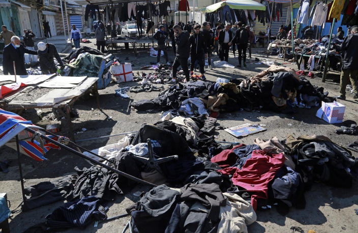 Security forces work at the site of a deadly bomb attack in Baghdad, Iraq, Thursday, Jan. 21, 2021. Iraq's military said twin suicide bombings at the Bab al-Sharqi commercial area in central Baghdad Thursday ripped through the busy market killing over two dozen and wounding over 70, with some in serious condition. (AP Photo/Hadi Mizban)