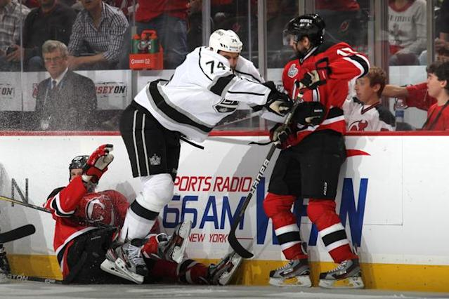 NEWARK, NJ - JUNE 02: Dwight King #74 of the Los Angeles Kings makes contact with Peter Harrold #10 of the New Jersey Devils during Game Two of the 2012 NHL Stanley Cup Final at the Prudential Center on June 2, 2012 in Newark, New Jersey. (Photo by Bruce Bennett/Getty Images)