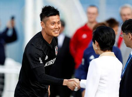 Soccer Football - World Cup - Japan Training - Japan Training Camp, Kazan, Russia - June 21, 2018 Japan's Princess Takamado shakes hands with Eiji Kawashima during training REUTERS/John Sibley