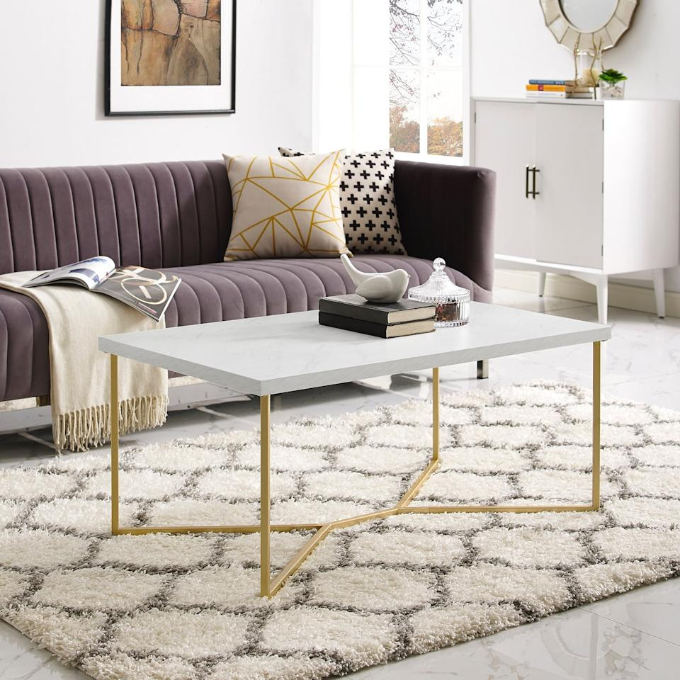"""<p>We love the look of this <a href=""""https://www.popsugar.com/buy/Rectangle-Coffee-Table-495357?p_name=Rectangle%20Coffee%20Table&retailer=walmart.com&pid=495357&price=104&evar1=casa%3Aus&evar9=45851020&evar98=https%3A%2F%2Fwww.popsugar.com%2Fphoto-gallery%2F45851020%2Fimage%2F46689609%2FRectangle-Coffee-Table&list1=home%2Chome%20decor%2Cfurniture%2Cwalmart%2Chome%20shopping&prop13=api&pdata=1"""" rel=""""nofollow"""" data-shoppable-link=""""1"""" target=""""_blank"""" class=""""ga-track"""" data-ga-category=""""Related"""" data-ga-label=""""https://www.walmart.com/ip/Rectangle-Coffee-Table-with-White-Faux-Marble-Top-and-Gold-Base/721853613"""" data-ga-action=""""In-Line Links"""">Rectangle Coffee Table</a> ($104).</p>"""
