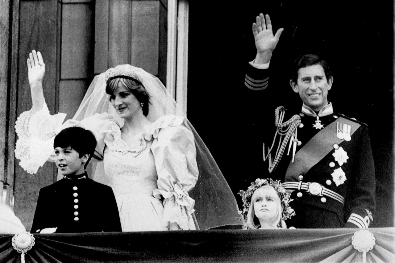 FILE- This July 29, 1981 file photo shows Prince Charles, right, and his bride Princess Diana as they wave from a balcony of Buckingham Palace on their wedding day in London. Tourists flocking to London for the royal wedding of Prince William and his bride Kate Middleton with a broader interest in Britain's monarchy have their pick of castles, museums and other attractions offering tours and exhibits.