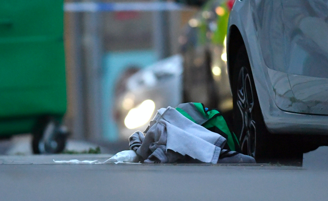 <em>Items left at the scene of the stabbing (PA)</em>