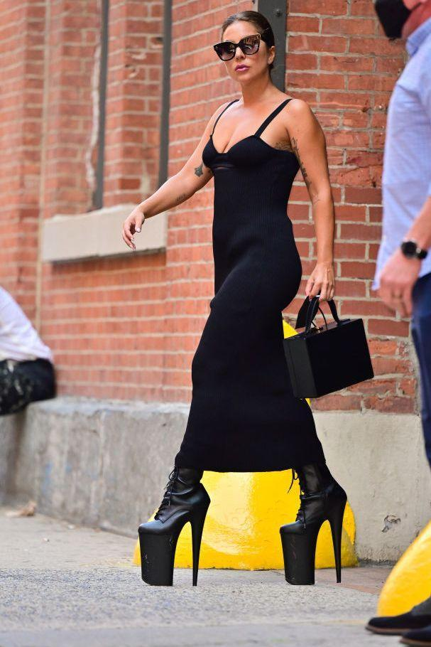 """<p>Giving us serious Bad Romance music video flashbacks, Gaga made a serious arrival on the streets of Manhattan on July 26 in these mighty heeled lace-up boots rumoured to be by Pleaser. She paired the towering heels with a Magda Butrym ribbed knit black maxi dress, which retails for £990.</p><p><a class=""""link rapid-noclick-resp"""" href=""""https://www.mytheresa.com/en-gb/magda-butrym-ribbed-knit-maxi-dress-1906935.html"""" rel=""""nofollow noopener"""" target=""""_blank"""" data-ylk=""""slk:SHOP LADY GAGA'S DRESS"""">SHOP LADY GAGA'S DRESS</a></p>"""
